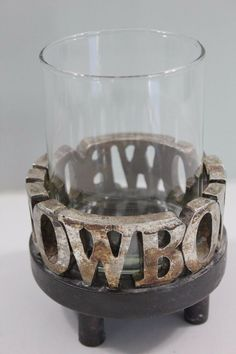 Cowboy candle holder can be used with glass or without. Without will hold a votive but if you use the glass it needs to be a little smaller than that.
