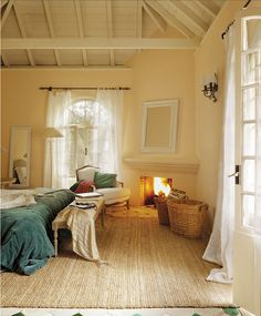 Coasts & Castles Spanish Guesthouse Marbella 11~love the rug, velvet duvet cover and the fireplace.