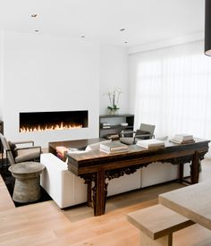 In the Pacific Heights neighborhood of San Francisco, what started off as a decorating job turned into a full-blown renovation for Nicole Hollis. The living room and dining room were originally separated by a central fireplace, which Hollis removed to create this great room. She installed a custom eight-foot-long open gas fireplace in the living room (equipped with sensors that automatically turn it off when someone gets too near to the flames).