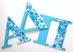 these hand painted mdf letters are for alpha delta pi they feature adpis signature colors