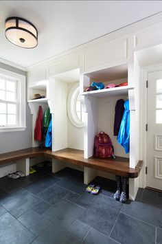 Mudroom Design.Having a well-designed mudroom is always a smart investment. Look for easy storage solutions or invest on custom built-ins. These are more expensive, but will be designed specifically for the space you have. Another very important factor when designing a mudroom is the flooring. Choose durable, hard-wearing floors such as tiles, natural stone, brick, cork flooring or high quality vinyl. The flooring in this mudroom is slate. #Mudroom #MudroomDesign #MudroomIdeas.