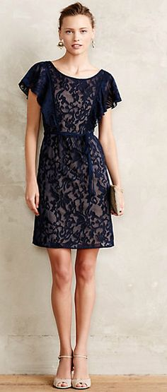 Love this navy lace flutter sleeve dress from Anthropologie! #weddingguest