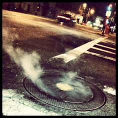 Smoking manhole cover.
