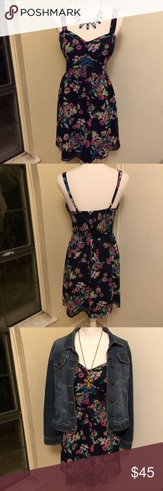 Candie's DARK BLUE Floral Dress *Like New* This awesome dress can be dressed up or down. It is super flattering and feminine. It features a dark blue lining and a half elastic waist hidden in the back which makes it ultra comfortable. The straps ARE adjustable. Looks great with a denim jacket or light cardigan. Worn and washed only once, wore to a family dinner. *Perfect for bundling with the pink dress in another listing.* Candie's Dresses