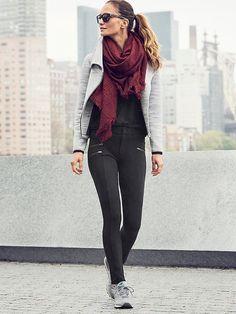 Gray moto style jacket, black pants, scarf