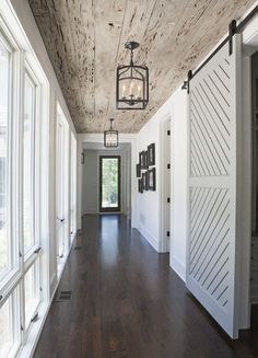 textured barn doors - two-panel raised diagonal plank gray painted barn door - Rachel Halvorson via Atticmag