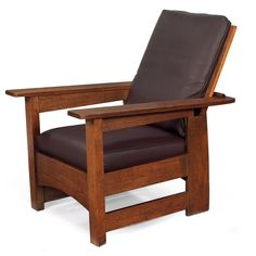"""Description: Limbert Morris chair, flat-arm form with arched rail and curved rear legs, some retouch to original finish, branded signature, 28.5""""w x 38.5""""d x 36""""h, very good condition  Estimated Value: $1,200 - $1,500"""