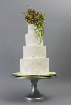 All white fall wedding cake with succulent on top by Cake Studio on satinice.com!