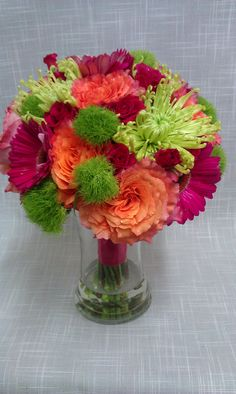 This bright citrus toned bouquet includes Free spirit roses, green trick dianthus, spider mums, gerbera daisies and hot majolica spray roses.