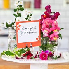 Ideal for self-serve drink bars and top-your-own-dessert tables, Mason jars make great stashing places for garnishes. Fill them with edible flowers, sliced fruit, candies, and more. /