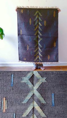 A patterned floor covering in naturally dyed fibers, this dhurrie is woven with jute dyed with vegetable and mineral pigments. After the dye bath, the jute is hand woven on the loom to form the arrows and dash pattern, in variegated hues of charcoal, terracotta and indigo. The muted palette adds natural texture to any space, the rug sized to fit in home and apartment entryways, living rooms and bedrooms.