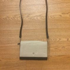 """Kate spade crossbody clutch Gently used and cleaned. Has card slots and a key zip slot. Only wear is to where it says """"KS"""" in gold, it is rubbing off a little, which is typical for Kate spade bags. kate spade Bags Crossbody Bags"""