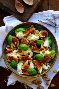 Mozzarella salad with fresh figs, basil, and pistacchios