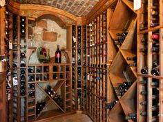 This home's game room is equipped with a wet bar and spacious wine cellar, and a home theater.
