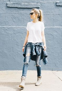 Try wearing your distressed jeans with tan suede boots, a casual white tee, and a denim shirt tied around your waist for a simple yet stylish look.