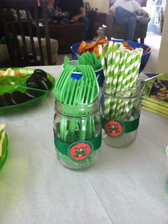 Green plastic tablewear and green and white striped paper straws for a Ninja Turtle party table. Ninja Party, Ninja Turtle Party, Ninja Turtles, Drake's Birthday, 4th Birthday Parties, Birthday Ideas, Mutant Ninja, Teenage Mutant, Birthday Party Centerpieces
