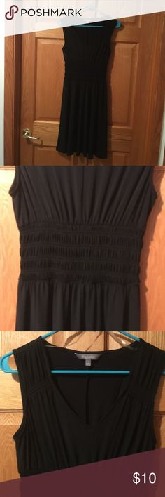 Daisy Fuentes little black v-neck dress Daisy Fuentes size S slip on little black v-neck dress, sleeveless, gathered waistline.  New never worn, but no tags.    Wear with flats or dress up with heels! Daisy Fuentes Dresses