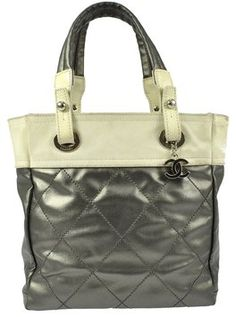 Chanel Silver Nylon Quilted Hand Vintage Italy Metallics Tote Bag. Get one of the hottest styles of the season! The Chanel Silver Nylon Quilted Hand Vintage Italy Metallics Tote Bag is a top 10 member favorite on Tradesy. Save on yours before they're sold out!