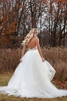 Marisa Bridals Style: D78 Luxury in silk. Our stretch silk satin draped so slightly, with boulion belt and detachable yards of tulle train with wide horsehair trim are perfection for any bride Fabrics: Silk Available colors: Ivory