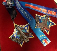 Fifty States Half Marathon Club MEMBER'S BLING #halfmarathon - 50 States Half Marathon Challenge and 100 half anywhere challenge  - 100 half marathon - 100 half marathons - 50 half marathons in 50 states - #running a half marathon in 50 states - running 100 half marathons and 7 Continents Endurance Challenge - 500 Endurance Challenge. 2014 HALF MARATHON FINISHER MEDALS of our 50 States Half Marathon Club members. www.halfmarathonclub.com This is from Space Coast Half Marathon 2014