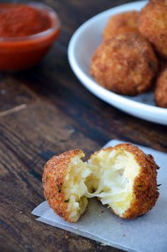 Arancini (Rice Balls) with Marinara Sauce,Yield8,Prep Time15 minCook Time 5 min, Ingredients 2 cups cooked white rice, cooled, ½ cup grated Parmesan, 3 eggs, separated, 8 small cubes fresh mozzarella, 1 cup Italian-style breadcrumbs,Oil, for frying, 1 cup marinara sauce