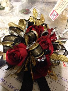 Gold red and black prom corsage
