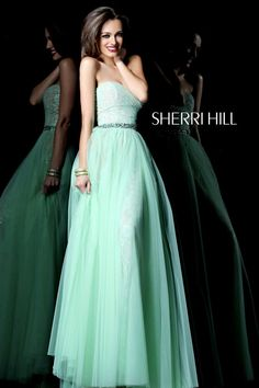 Sherri Hill 1579 on Song Costa - Delicate lace peeks through from under  tulle in this lovely ball gown style prom dress for 8b2be90e5