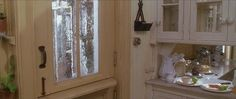 Tour the Victorian house in the movie, Practical Magic. I want a Dutch door with old blown glass.