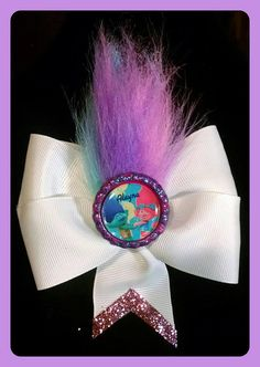 Pretty white hair bow with rainbow pink, lavender and teal trolls hair and personalized embellishment. | Shop this product here: http://spreesy.com/girlsjustwannahavfunbowtique/213 | Shop all of our products at http://spreesy.com/girlsjustwannahavfunbowtique    | Pinterest selling powered by Spreesy.com