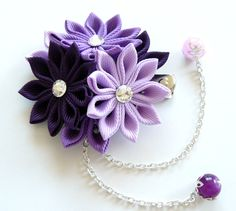 A flower is made in the technique of tsumami kanzashi. Alligator type hair clip . Flower is made from grosgrain ribbons. Swarovski crystal.  Flower`s