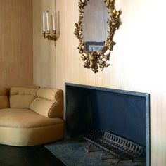 Philip Johnson's minimal fireplace and panelling vs Dominique de Menil and Charles James' gilded rococo and soft curves in her dining room.