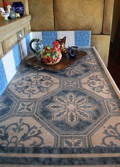 Skimstone & Modello® Designs countertop by artist Julie Young.