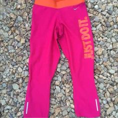 """Rare Nike pro Capri workout leggings Never worn! Hot pink with hot orange band and """"Just do it"""" on the side of the leg. Will fit xs and s. Will trade for Nike pro shorts in xs Nike Pants Capris"""