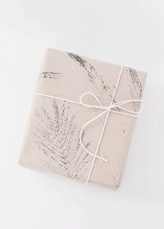 Simple DIY gift wrapping idea: use leaves as stamps.