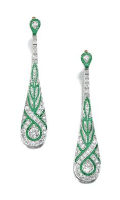 Emerald and diamond ear pendants. Each tapered drop millegrain-set with calibré-cut emeralds, highlighted with circular-cut diamonds, hinged post fittings. Art Deco or Art Deco style