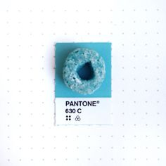 Pantone 630 color match. The blue Fruit Loop. The challenge was to find a loop that's not too covered by the white icing so you can still see its color. If you've ever wondered what PMS colors they are, wonder no more.