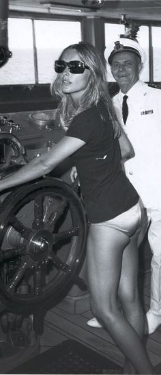 A crewman allowing Sharon to steer the Princess Italia during the press junket for Valley of The Dolls. | 1967.