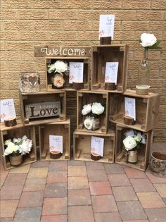 We love a unique table plan.  £35 hire fee  ( we don't print the seating plan )  Set includes 9 crates, 2 bark lanterns, jars o flowers and log bases for table plan cards.
