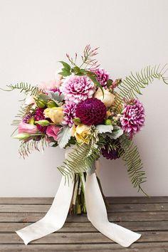 Purple dahlia bouquet | Brides.com