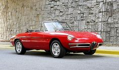 """The 1967 Alfa Romeo Spiders  """" Duetto ' with their tapered tails and  headlights are most desirable"""
