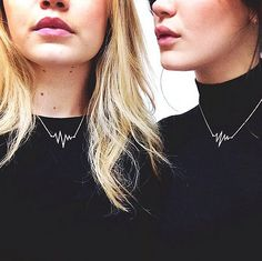 Bella Hadid bought her sister GIgi matching heartbeat necklaces.