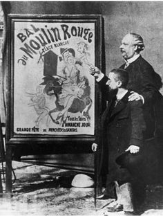 French painter Henri Toulouse-Lautrec (L) stands near one of his famous posters advertising the club with the director of the Moulin Rouge.