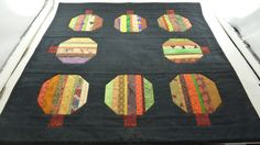 Halloween Pumpkins Table Mat 19 square.  Finished by Quiltbuilders