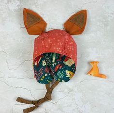 Let your imagination run wild! These gorgeous bonnets are works of art and fun to wear too. Each bonnet is reversible, featuring two beautiful fabrics. The removable ears add a special zing! to your c