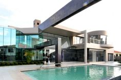 The House Cal located in South Africa is a sleek and stylish home with warm colors and glossy surfaces, designed by Nico van der Meulen. This house was Urban Architecture, Residential Architecture, Kempton Park, Pool Designs, Warm Colors, Vans, House Design, House Styles, Outdoor Decor