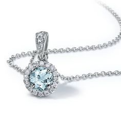 Delicate in design, this aquamarine and diamond pendant features a light blue, round aquamarine framed by micropavé-set diamonds in 18k white gold with a matching cable chain necklace.