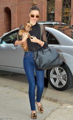Miranda Kerr flaunts a Givenchy tote and gold glitter rimmed shades in New York
