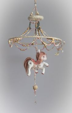 """Baby Girl Mobile """"Parisian Carousel"""" felt pony horse in neutral pink, cream, natural wood and grey gray by ALT ART STUDIO on Etsy."""