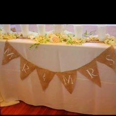 Bride & groom table. Later, filled with the bridesmaids bouquets <3