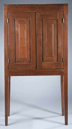 Louisiana Cherrywood Jelly Cupboard, mid-19th c., the top above raised panel doors, the sides with conforming raised panels, raised on tall tapered square legs, height 56 3/4 in., width 30 in., depth 16 1/4 in.